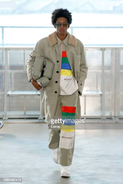 A model walks the runway at the Xander Zhou show during London Fashion Week Men's January 2019 January 6 2019 in London England