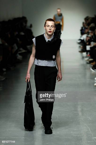 A model walks the runway at the Xander Zhou show during London Fashion Week Men's January 2017 collections at BFC Show Space on January 6 2017 in...