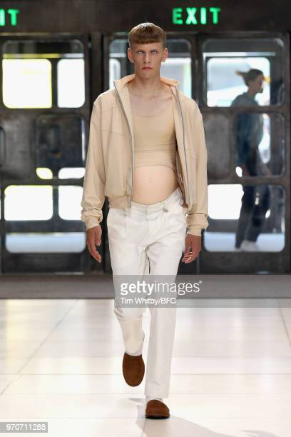 A model walks the runway at the Xander Zhou show during London Fashion Week Men's June 2018 at Queen Elizabeth Hall on June 10 2018 in London England