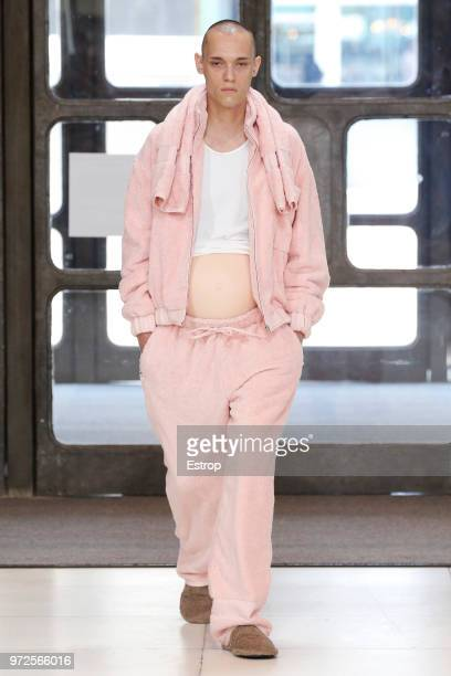 A model walks the runway at the Xander Zhou show during London Fashion Week Men's June 2018 Queen Elizabeth Hall on June 10 2018 in London England