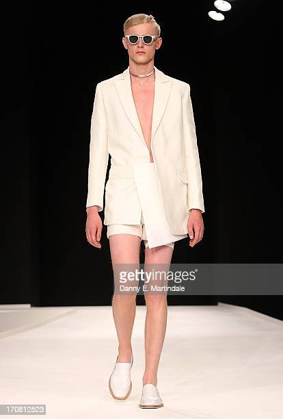 A model walks the runway at the Xander Zhou show during the London Collections MEN SS14 at The Old Sorting Office on June 18 2013 in London England
