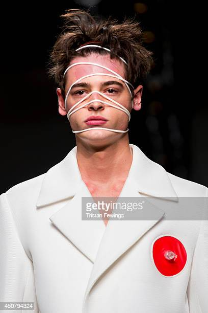 A model walks the runway at the Xander Zhou show during the London Collections Men SS15 on June 17 2014 in London England