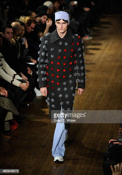 A model walks the runway at the Xander Zhou show during The London Collections Men Autumn/Winter 2014 on January 6 2014 in London England