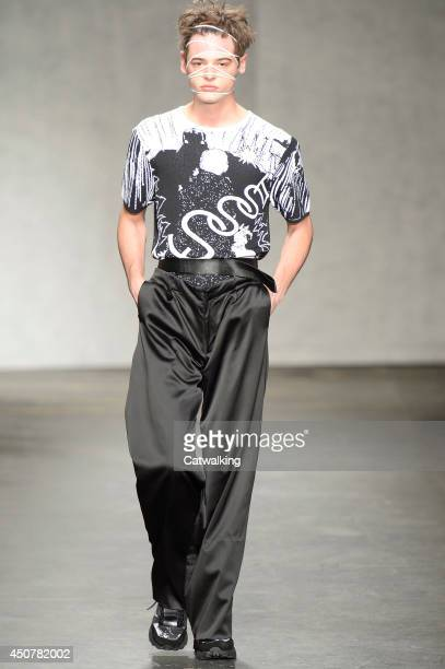 A model walks the runway at the Xander Zhou Spring Summer 2015 fashion show during London Menswear Fashion Week on June 17 2014 in London United...