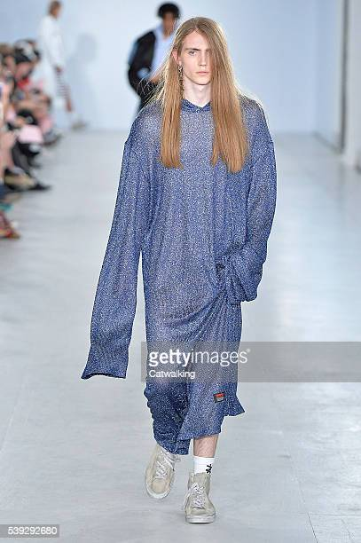 Model walks the runway at the Xander Zhou Spring Summer 2017 fashion show during London Menswear Fashion Week on June 10, 2016 in London, United...
