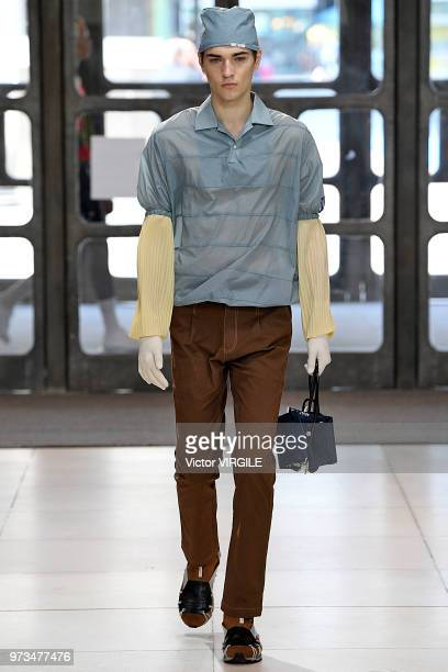 A model walks the runway at the Xander Zhou Spring/Summer 2019 fashion show during London Fashion Week Men's June 2018 on June 10 2018 in London...