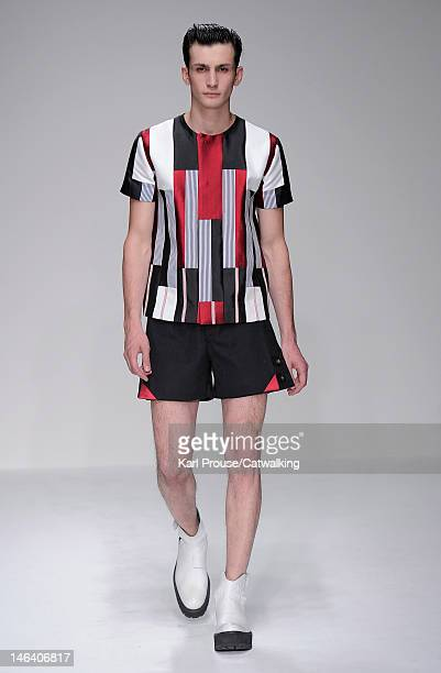 A model walks the runway at the Xander Zhou Summer 2013 fashion show during London Menswear Fashion Week on June 15 2012 in London United Kingdom
