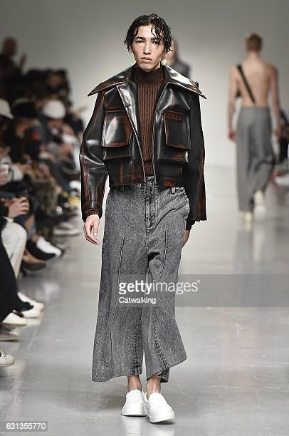 Model walks the runway at the Ximon Lee Autumn Winter 2017 fashion show during London Menswear Fashion Week on January 8, 2017 in London, United...
