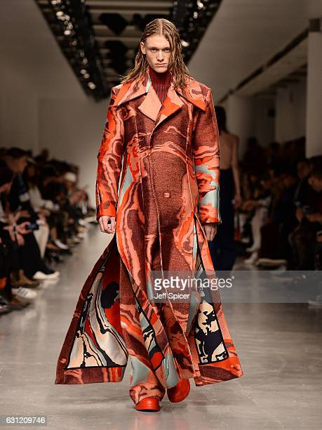 A model walks the runway at the Ximon Lee show during London Fashion Week Men's January 2017 collections at BFC Show Space on January 8 2017 in...