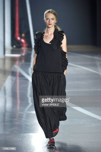 Model walks the runway at the Y-3 Spring 2012 fashion show during Mercedes-Benz Fashion Week at 82 Mercer on September 11, 2011 in New York City.