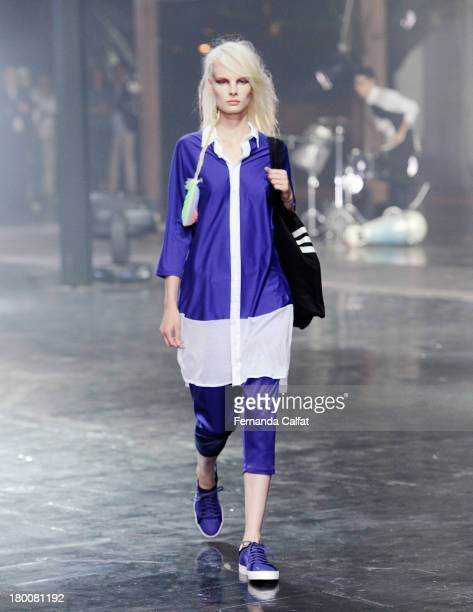 A model walks the runway at the Y3 Spring/Summer 2014 show during MercedesBenz Fashion Week on September 8 2013 in New York City