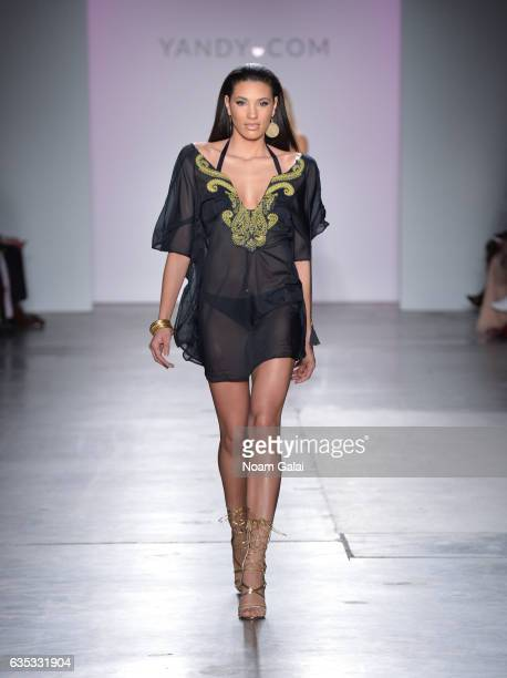A model walks the runway at the Yandy Swim Show during February 2017 New York Fashion Week at Pier 59 on February 14 2017 in New York City