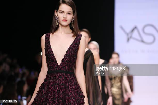 A model walks the runway at the YASYA MINOCHKINA fashion show during day one of Mercedes Benz Fashion Week Russia Fall/Winter 2018/19 at Manege at...
