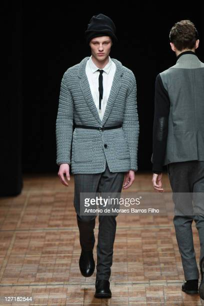Model walks the runway at the Yigal Azrouel show as part of Paris Menswear Fashion Week Fall/Winter 2011-2012 at Maison de La Chimie on January 23,...