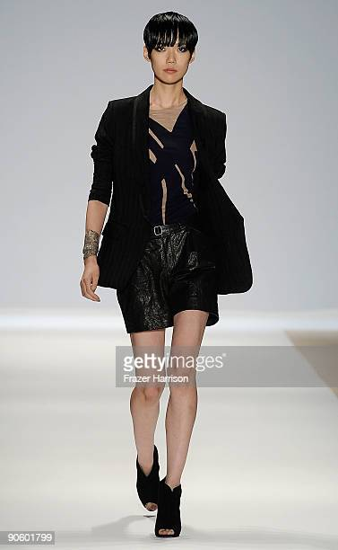 A model walks the runway at the Yigal Azrouel Womenswear Spring 2010 Fashion Show presented by MercedesBenz at Bryant Park on September 11 2009 in...