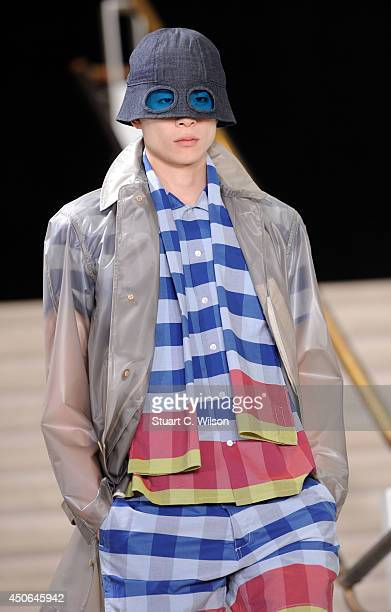Model walks the runway at the YMC show during the London Collections: Men SS15 at The British Library on June 15, 2014 in London, England.