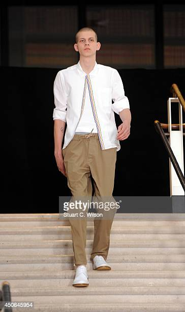 A model walks the runway at the YMC show during the London Collections Men SS15 at The British Library on June 15 2014 in London England