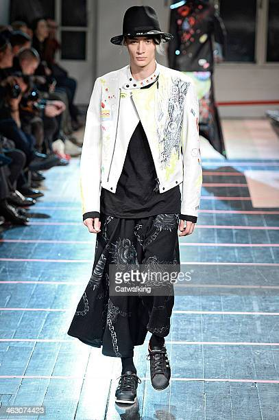 A model walks the runway at the Yohji Yamamoto Autumn Winter 2014 fashion show during Paris Menswear Fashion Week on January 16 2014 in Paris France