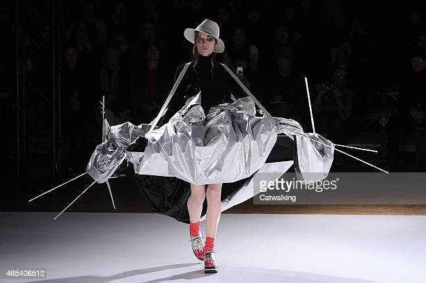 A model walks the runway at the Yohji Yamamoto Autumn Winter 2015 fashion show during Paris Fashion Week on March 6 2015 in Paris France