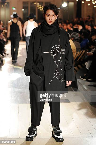 A model walks the runway at the Yohji Yamamoto Autumn Winter 2016 fashion show during Paris Menswear Fashion Week on January 21 2016 in Paris France