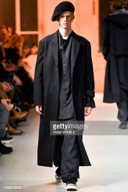 Model walks the runway at the Yohji Yamamoto Menswear- Fall Winter 2021/2021 fashion show as part of the Paris Menswear Fashion Week on January 16,...