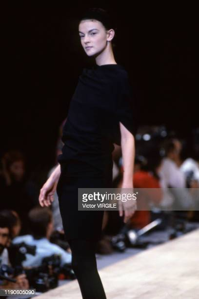 Model walks the runway at the Yohji Yamamoto Ready to Wear Spring/Summer 1990 fashion show during the Paris Fashion Week in October, 1989 in Paris,...