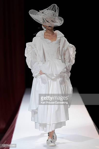 Model walks the runway at the Yohji Yamamoto Spring Summer 2012 fashion show during Paris Fashion Week on September 30, 2011 in Paris, France.