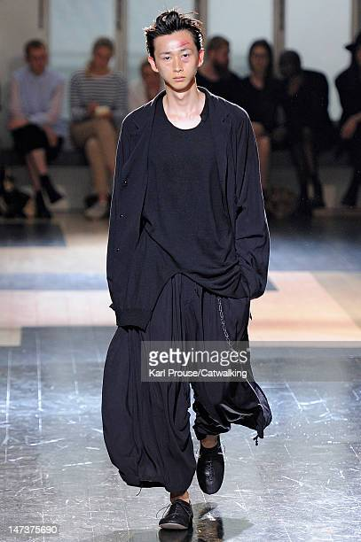 Model walks the runway at the Yohji Yamamoto Spring Summer 2013 fashion show during Paris Menswear Fashion Week on June 28, 2012 in Paris, France.