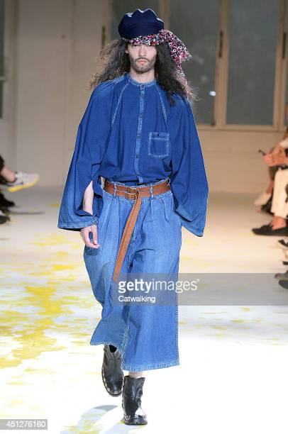 Model walks the runway at the Yohji Yamamoto Spring Summer 2015 fashion show during Paris Menswear Fashion Week on June 26, 2014 in Paris, France.