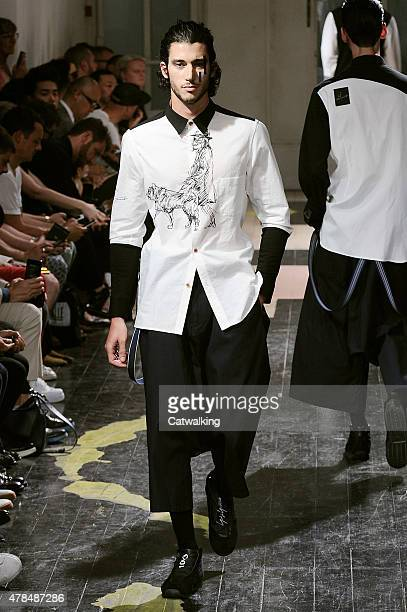 Model walks the runway at the Yohji Yamamoto Spring Summer 2016 fashion show during Paris Menswear Fashion Week on June 25, 2015 in Paris, France.