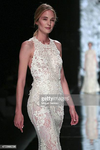 A model walks the runway at the YolanCris fashion show as part of 'Barcelona Bridal Week 2015' on May 6 2015 in Barcelona Spain