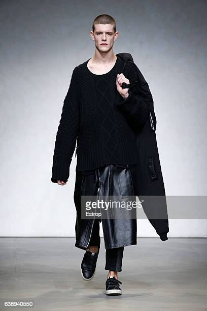 A model walks the runway at the Yoshio Kubo show during Milan Men's Fashion Week Fall/Winter 2017/18 on January 17 2017 in Milan Italy