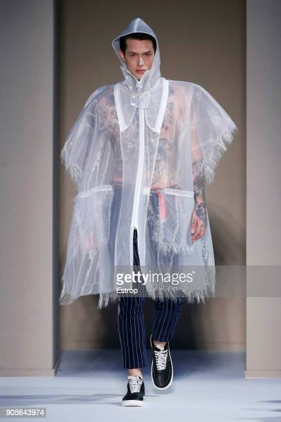 A model walks the runway at the Yoshio Kubo show during Milan Men's Fashion Week Fall/Winter 2018/19 on January 15 2018 in Milan Italy