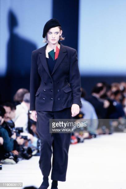 Model walks the runway at the Yoshji Yamamoto Ready to Wear Fall/Winter 1989-1990 fashion show during the Paris Fashion Week in March, 1989 in Paris,...