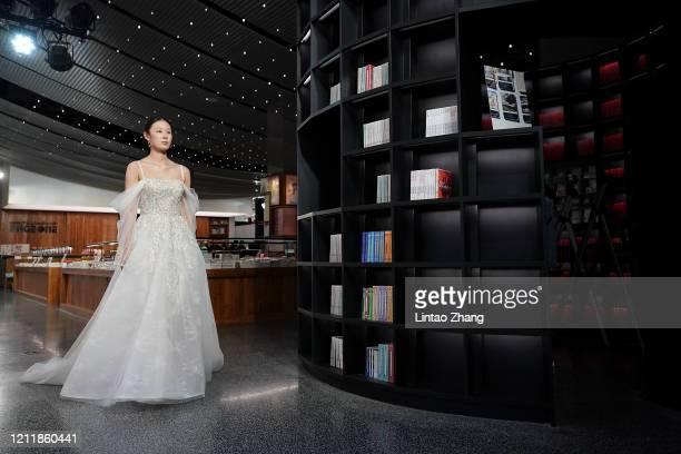 Model walks the runway at the YOSUN 10+3Remix collection show during the China Fashion Week 2020/2021 A/W Collection on May 5, 2020 in Beijing,...