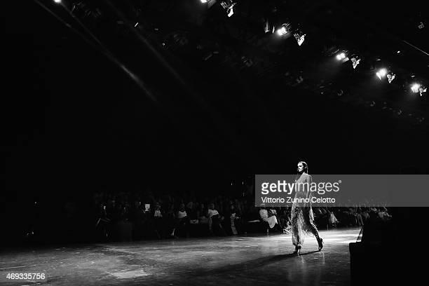 A model walks the runway at the Yousef AlJasmi show during Dubai Fashion Forward April 2015 at Madinat Jumeirah on April 11 2015 in Dubai United Arab...