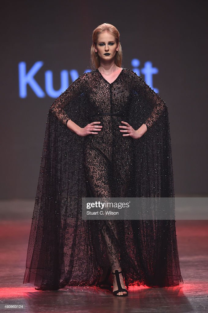 A model walks the runway at the Yousef Al-Jasmi show during