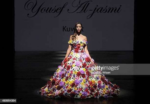 A model walks the runway at the Yousef AlJasmi show during Dubai Fashion Forward Spring/Summer 2016 at Madinat Jumeirah on October 23 2015 in Dubai...