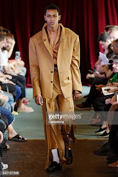 A model walks the runway at the Y/Project Spring Summer 2017 fashion show during Paris Menswear Fashion Week on June 22 2016 in Paris France