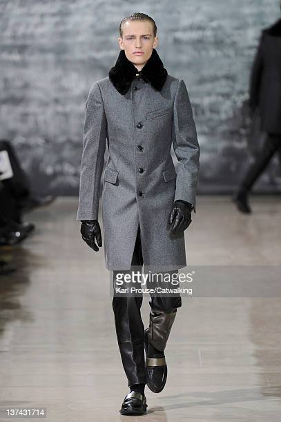 A model walks the runway at the Yves Saint Laurent Autumn Winter 2012 fashion show during Paris Menswear Fashion Week on January 20 2012 in Paris...