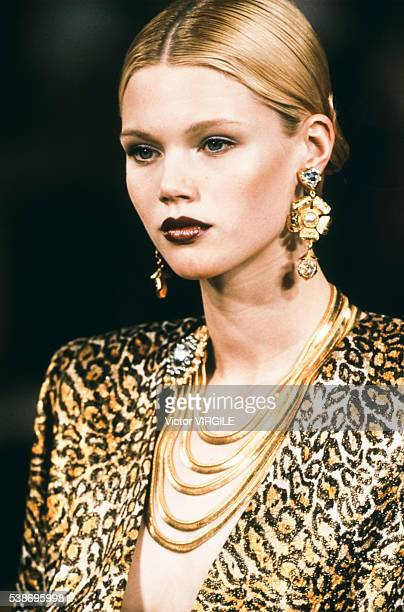 A model walks the runway at the Yves Saint Laurent Haute Couture Fall/Winter 19971998 fashion show during the Paris Fashion Week in July 1997 in...