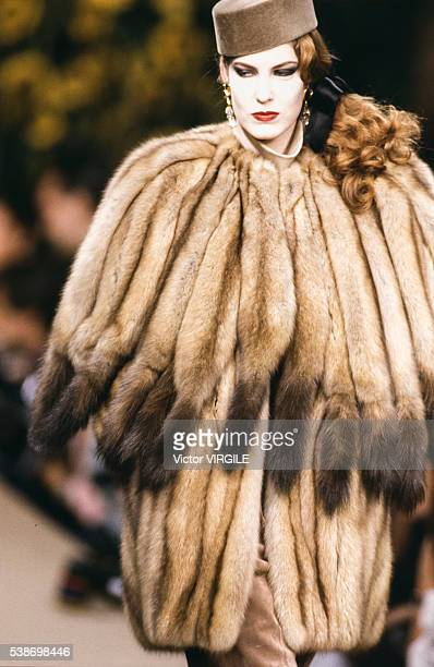 A model walks the runway at the Yves Saint Laurent Haute Couture Fall/Winter 19911992 fashion show during the Paris Fashion Week in July 1991 in...