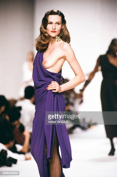 Model walks the runway at the Yves Saint Laurent Ready to Wear Spring/Summer 1990 fashion show during the Paris Fashion Week in October, 1989 in...