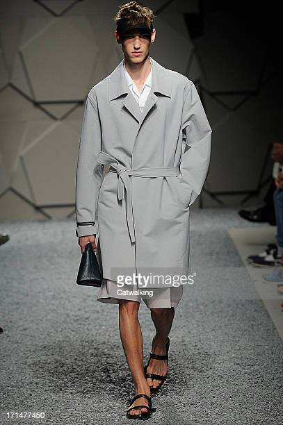 A model walks the runway at the Z Zegna Spring Summer 2014 fashion show during Milan Menswear Fashion Week on June 25 2013 in Milan Italy