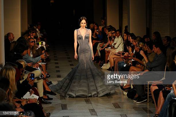 A model walks the runway at the Zac Posen Spring 2012 fashion show during MercedesBenz Fashion Week at Avery Fisher Hall Lincoln Center on September...