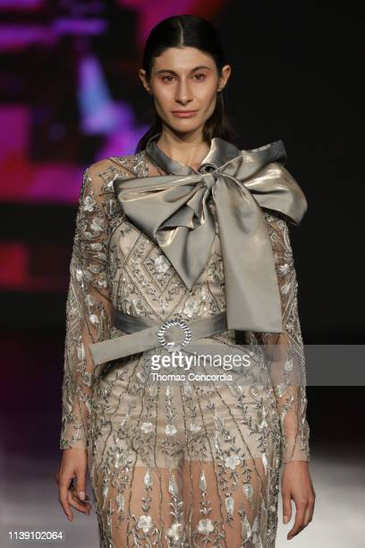 A model walks the runway at the Zainab Al Kisswani show during Jordan Fashion Week 019 at the Kempinski Amman on March 29 2019 in Amman Jordan