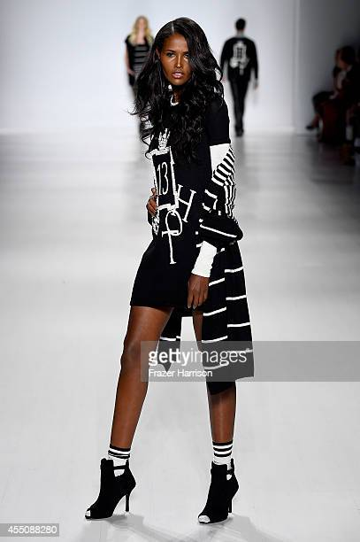 A model walks the runway at the Zang Toi fashion show during MercedesBenz Fashion Week Spring 2015 at Lincoln Center on September 9 2014 in New York...