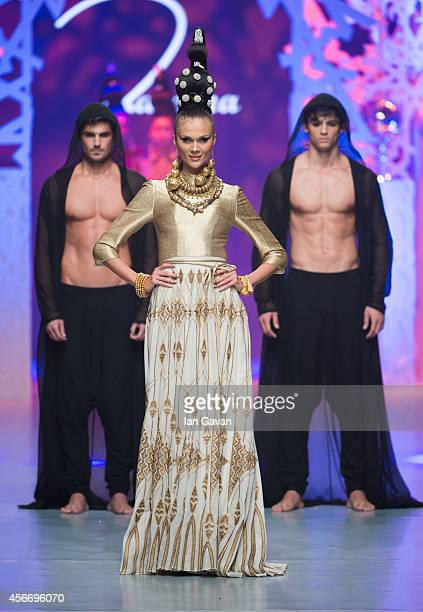 A model walks the runway at the Zareena show during Fashion Forward at Madinat Jumeirah on October 5 2014 in Dubai United Arab Emirates