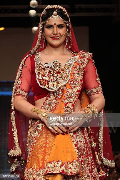 A model walks the runway at the Zarine Khan show during day 2 of the India International Jewellery Week 2014 at grand Hyatt on July 15 2014 in Mumbai...