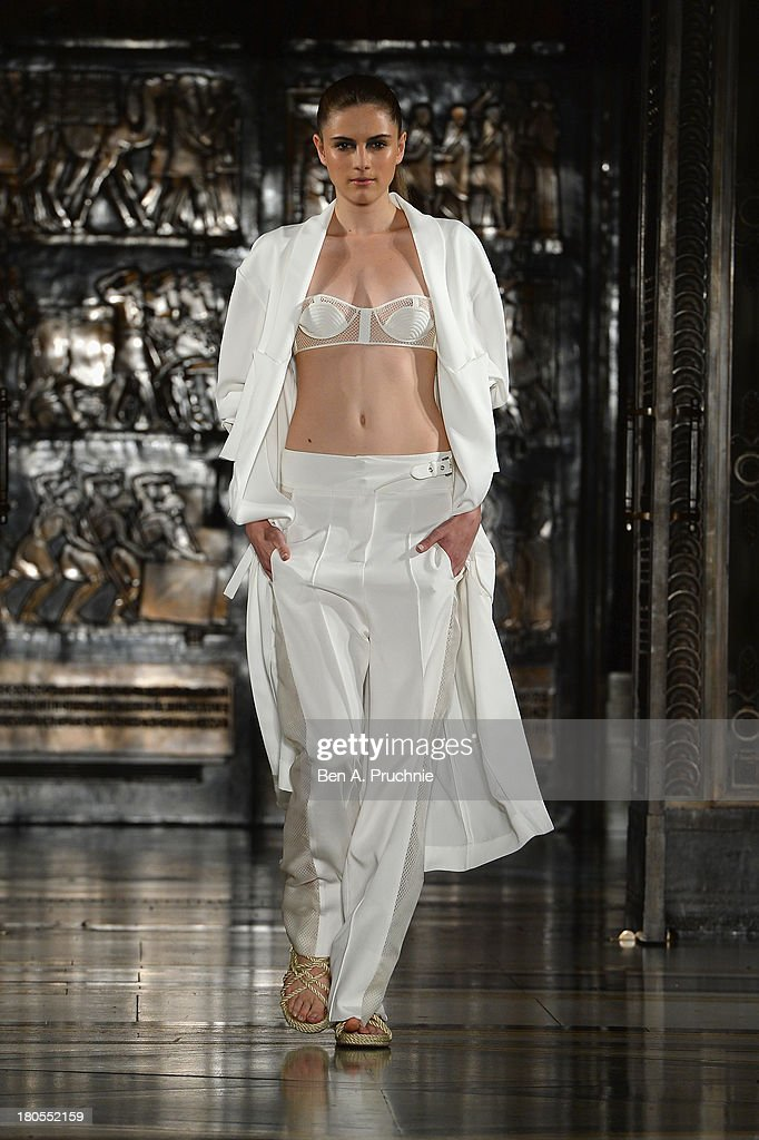 A model walks the runway at the Zeynep Tosun show during at the Fashion Scout venue during London Fashion Week SS14 at Freemasons Hall on September 14, 2013 in London, England.
